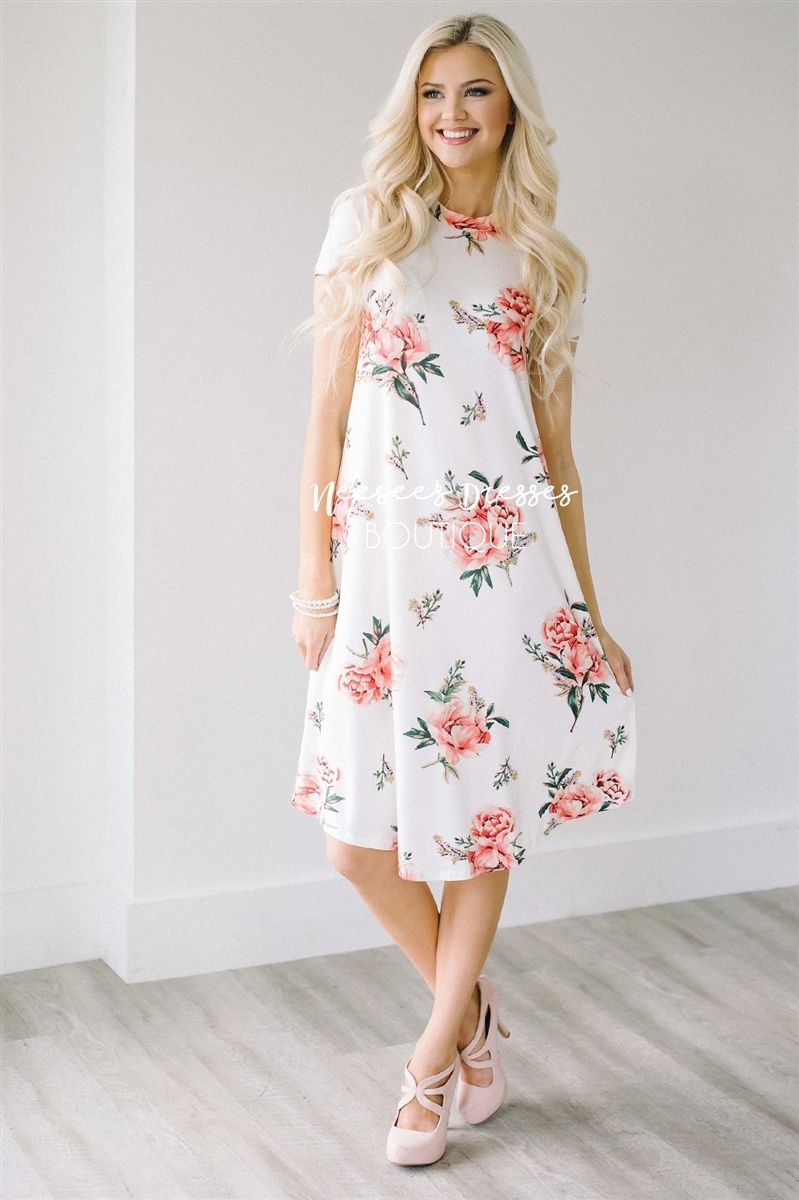 White pink peony swing dress beautiful white dresses you ve and this dress is everything youve been looking for and would be perfect for spring and summer days church or a day out beautiful white dress features a pink mightylinksfo