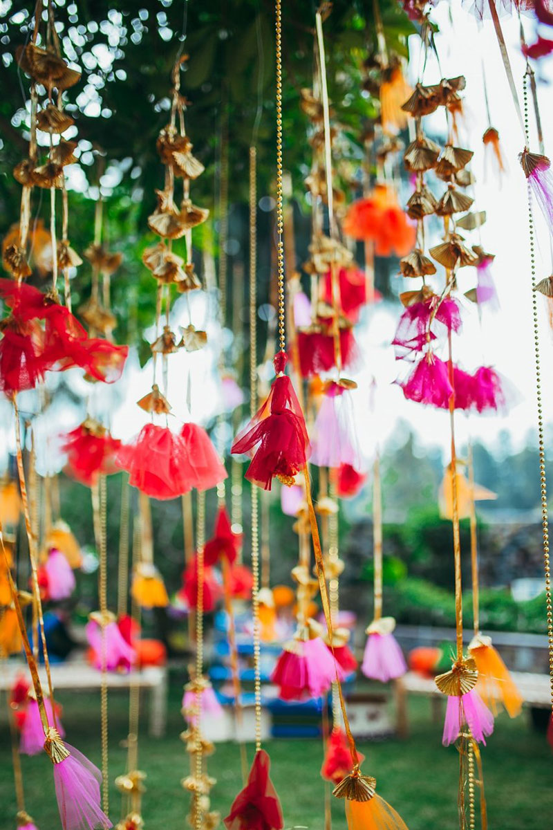 A colorful Indian wedding with so many outfit changes and decor that will blow your mind