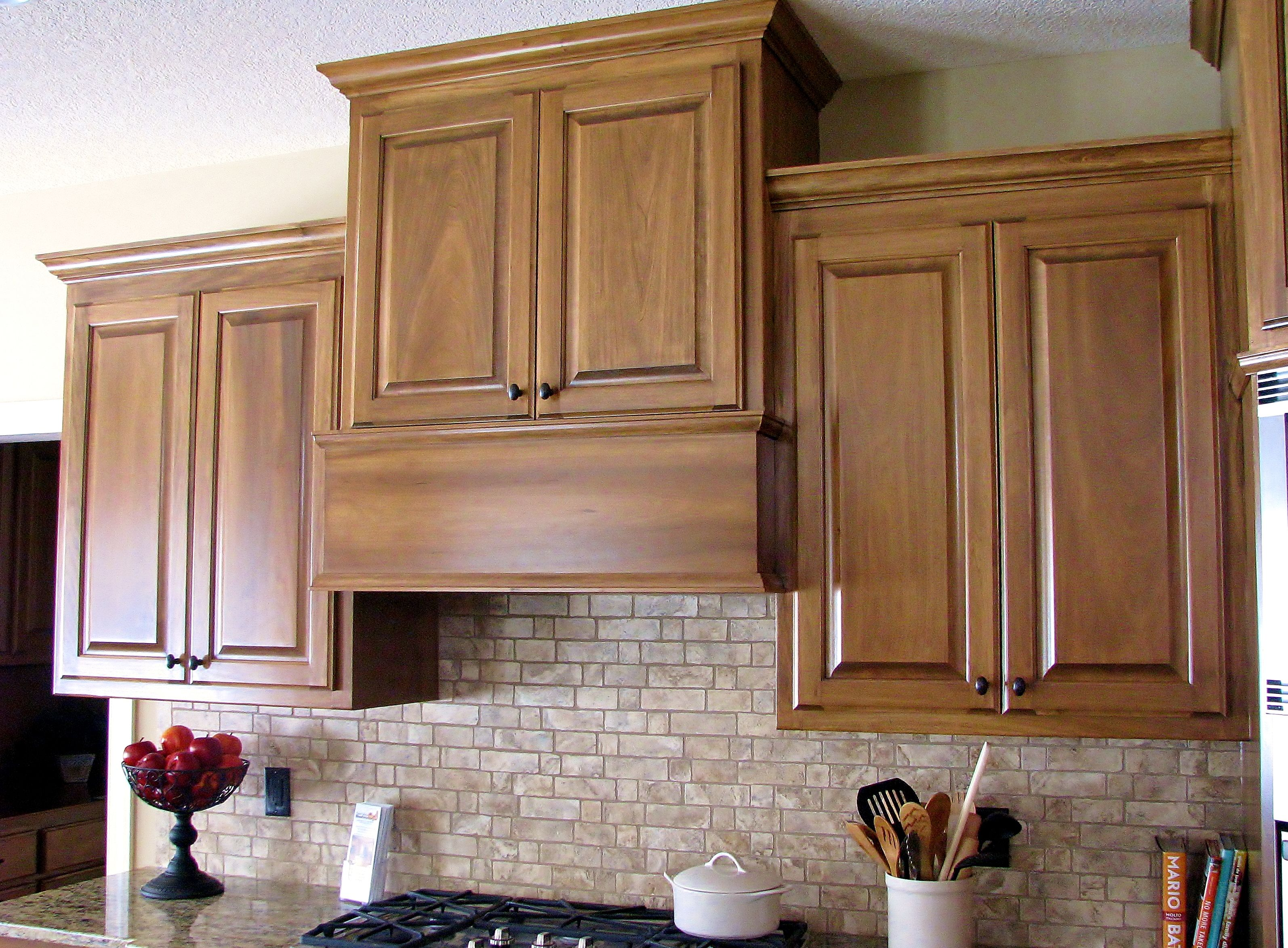Raise The Cabinet Above You Stove And Add Instant Style Made By Lakeside Cabinets And Wood Kitchen Cabinetry Design Custom Kitchens Custom Cabinets