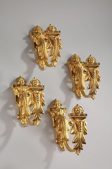 Four Napoleon III gilt bronze tiebacks