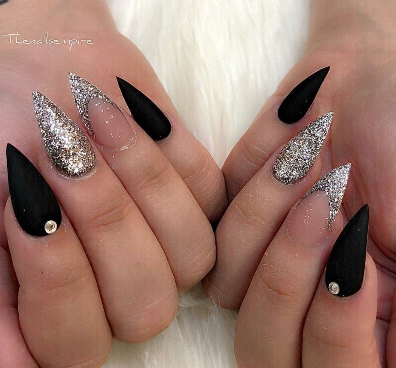 Silver and black pointy nails