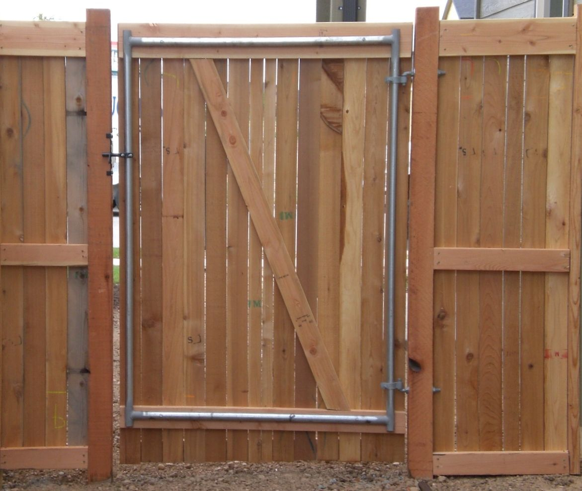 Frontier Fence Company Uses Metal Gate Frames To Better Support The Weight Of A Wooden Gate Wood Fence Cedar Gate Wood Gate