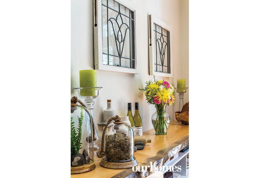 Credenza Con Vidrio : Vintage leaded glass windows hang above the dining room credenza