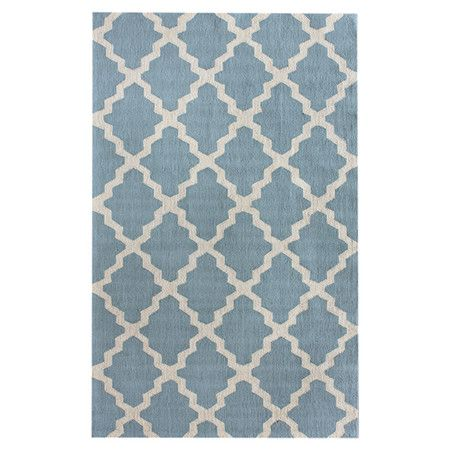 Hand-hooked wool rug with a blue and beige Moroccan trellis motif.  Product: RugConstruction Material: Wool...