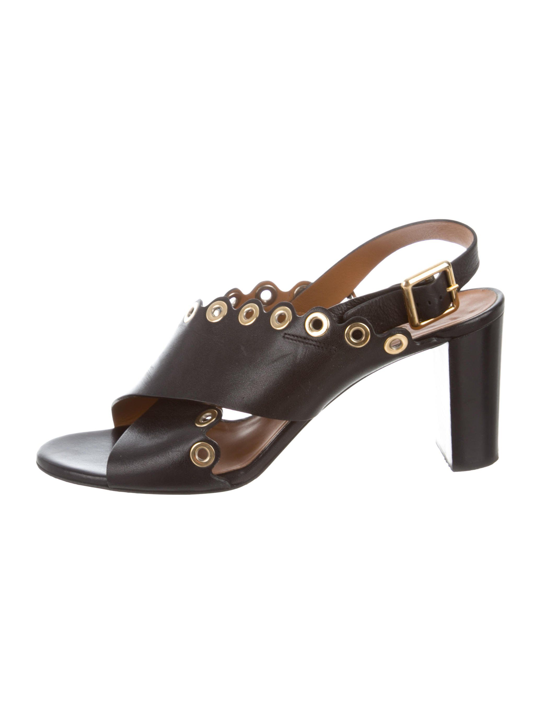 7df78ba65 Black leather Chloé sandals with gold-tone grommets at scalloped top lines