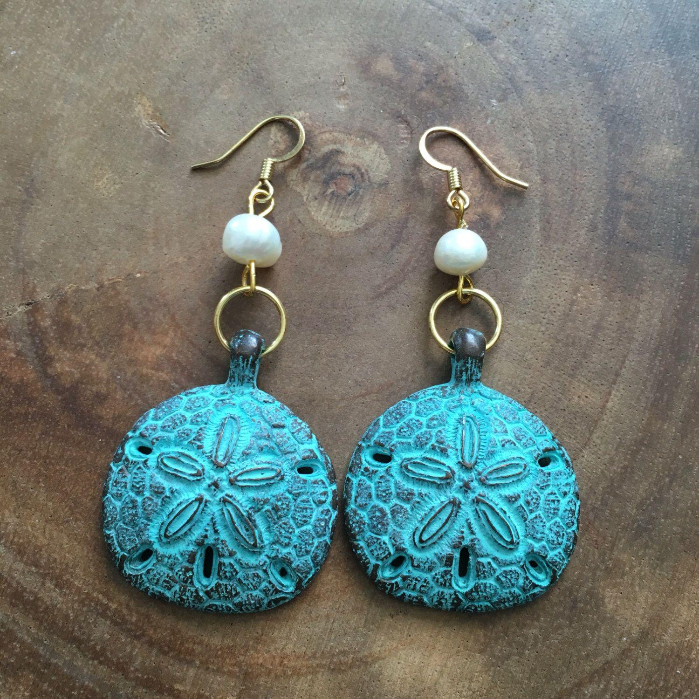 A personal favorite from my Etsy shop https://www.etsy.com/listing/474800757/sand-dollar-earrings-beach-earrings