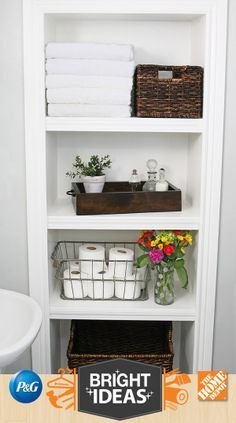 open shelves create perfect bathroom storage love the folded towels and tp basket