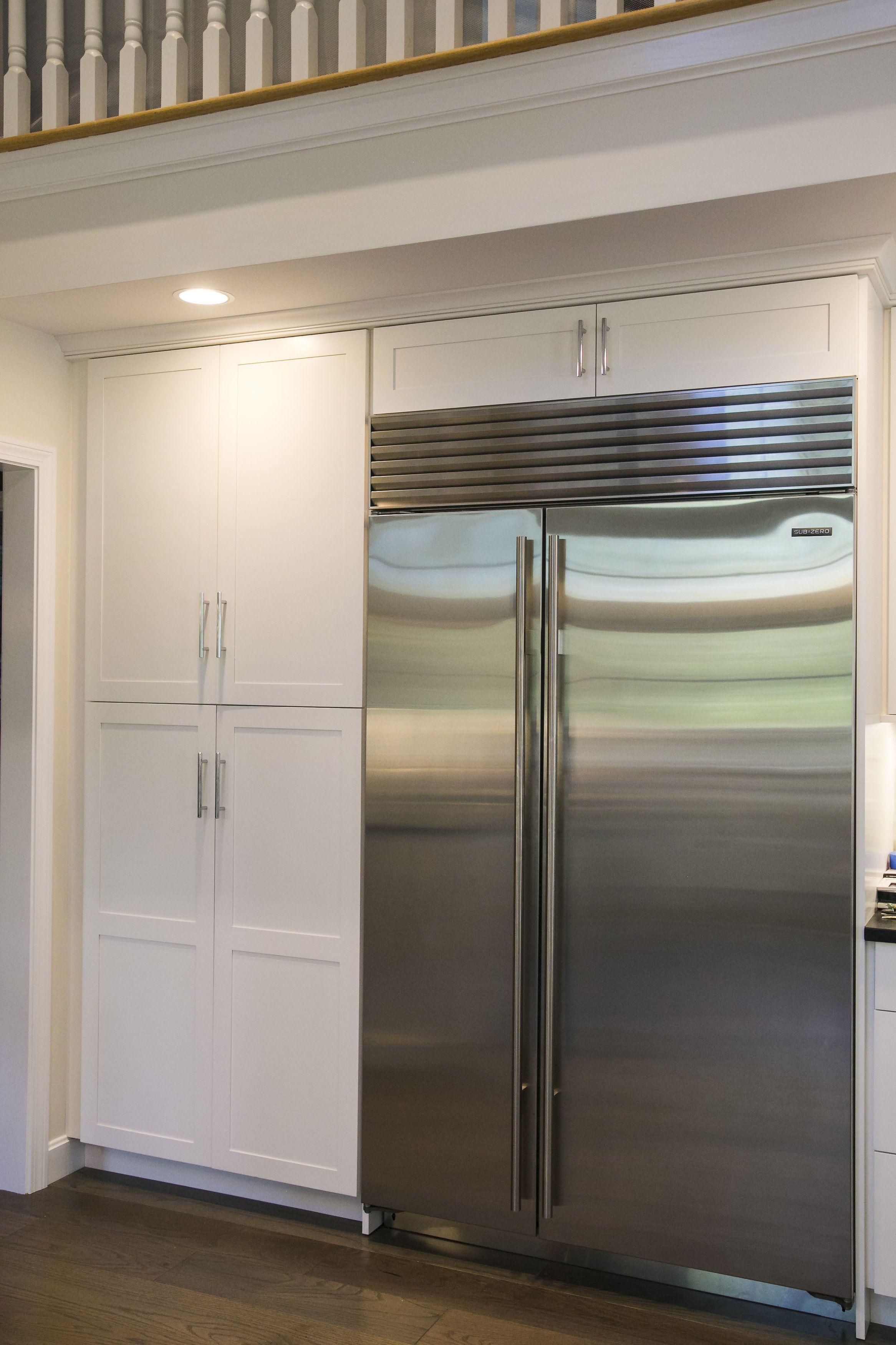 White Shaker Cabinets With Modern Brushed Nickel Finishes Custom Built Around Subzero Refrigerator White Shaker Cabinets Kitchen Cabinets Trim Shaker Cabinets