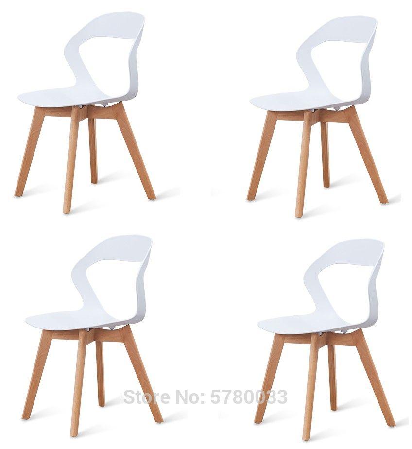 طقم من 4 كراسي ارجل خشبيه مناسبه لغرفة الطعام والجلوس متوفره بالالوان الأبيض والاسود والبنيa Set Of 4 Minimalist Chair Brown Dining Chairs Cheap Dining Chairs
