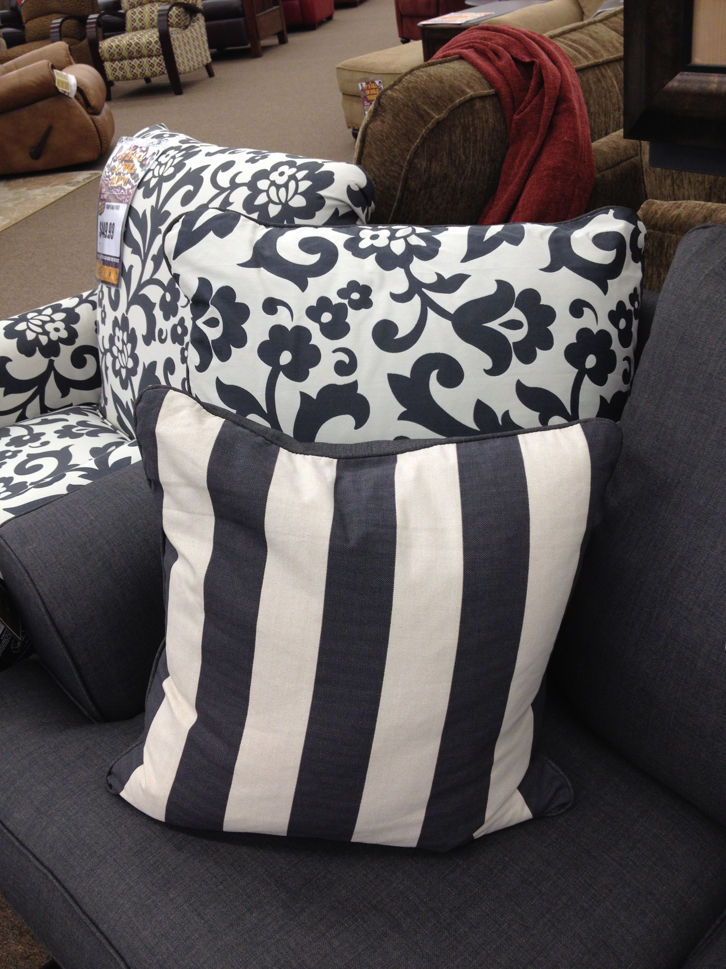 White and grey blue stripes plement the floral print on this