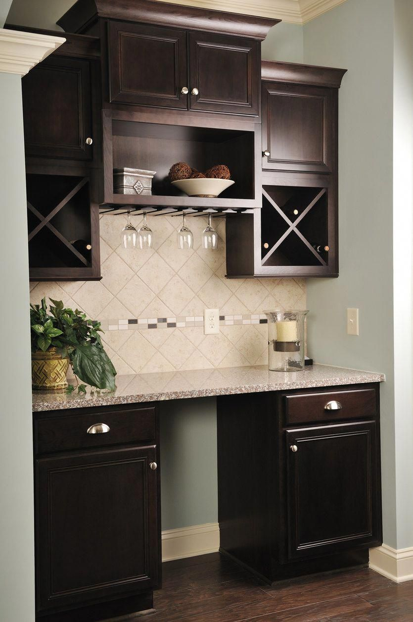 Great built in small dark wood wet bar built into a small ...