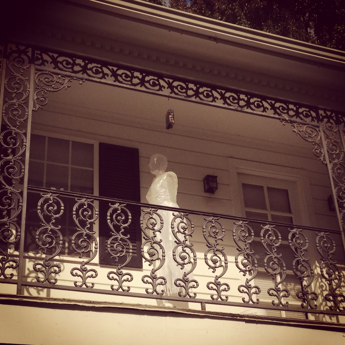 Super Simple Ideas For People Who Hate Yard Work: Packing Tape Ghost Hanging From The Balcony. Halloween