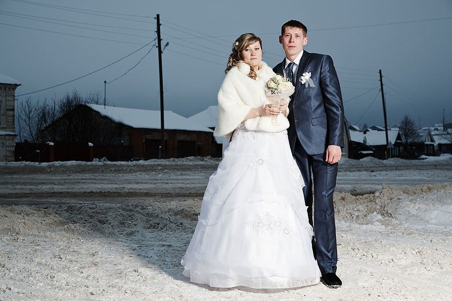 Russia      To battle the cold weather, a bride in Russia sported a white fur shawl over her wedding dress.