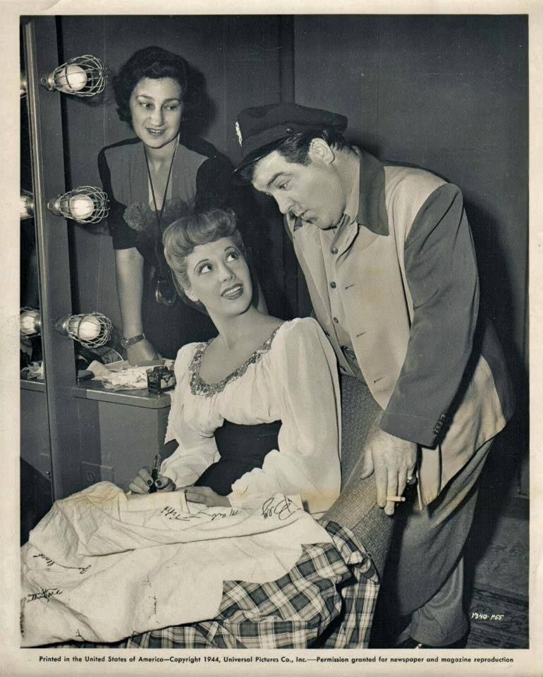 A behind the scenes shot of comic legend Lou Costello visiting singer Dinah Shore on the set of FOLLOW THE BOYS, circa 1944!