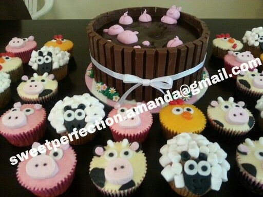Pigs in the mud cake with farm animal cupcakes.