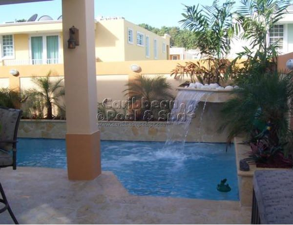 Caribbean pool and spa construcci n de piscinas en for Construccion de cascadas