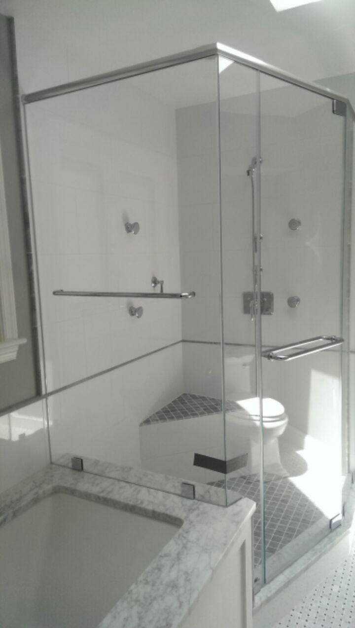 Frameless Shower Unit With Chrome Header And Three Fixed Panels