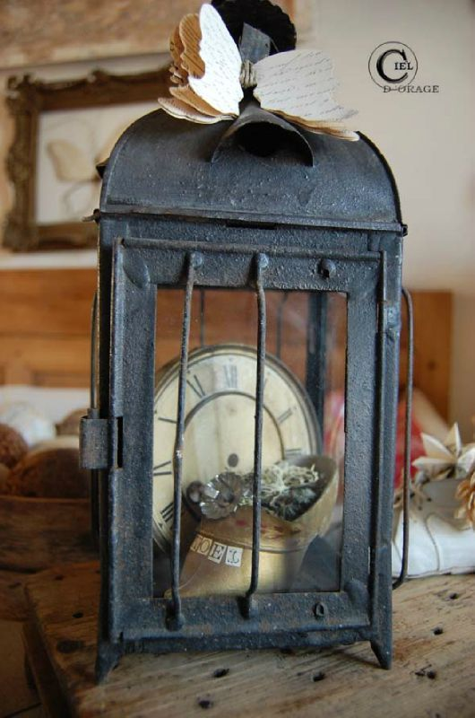 Love the clock inside a lantern - pretty, inexpensive, and I've already got a nice lantern! Awesome for a quick LARGE New Years decoration!