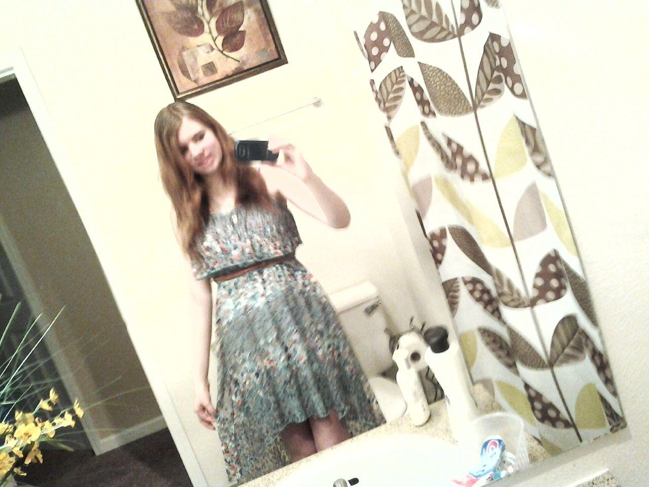 I love this dress it's one of my fav's it's a high low flower blue dress and it's mine(:
