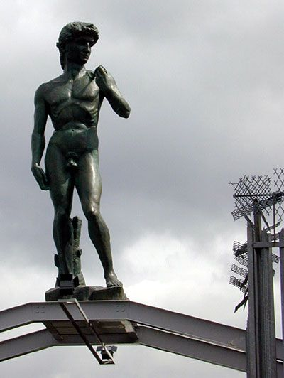 "18ft bronze ""replica"" of Michelangelo's David on roof of Cosmo Ceramics, Glasgow. The emaciated version."