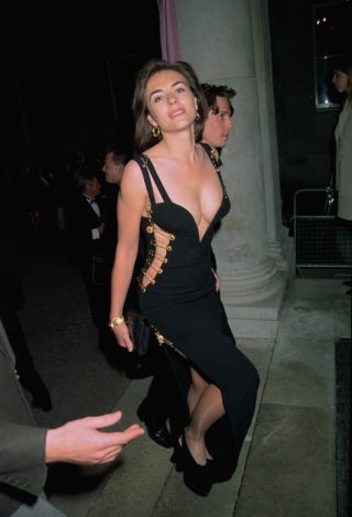 a39e9cd92d The 52 most scandalous celebrity looks of all time: Elizabeth Hurley's  Versace safety pin dress