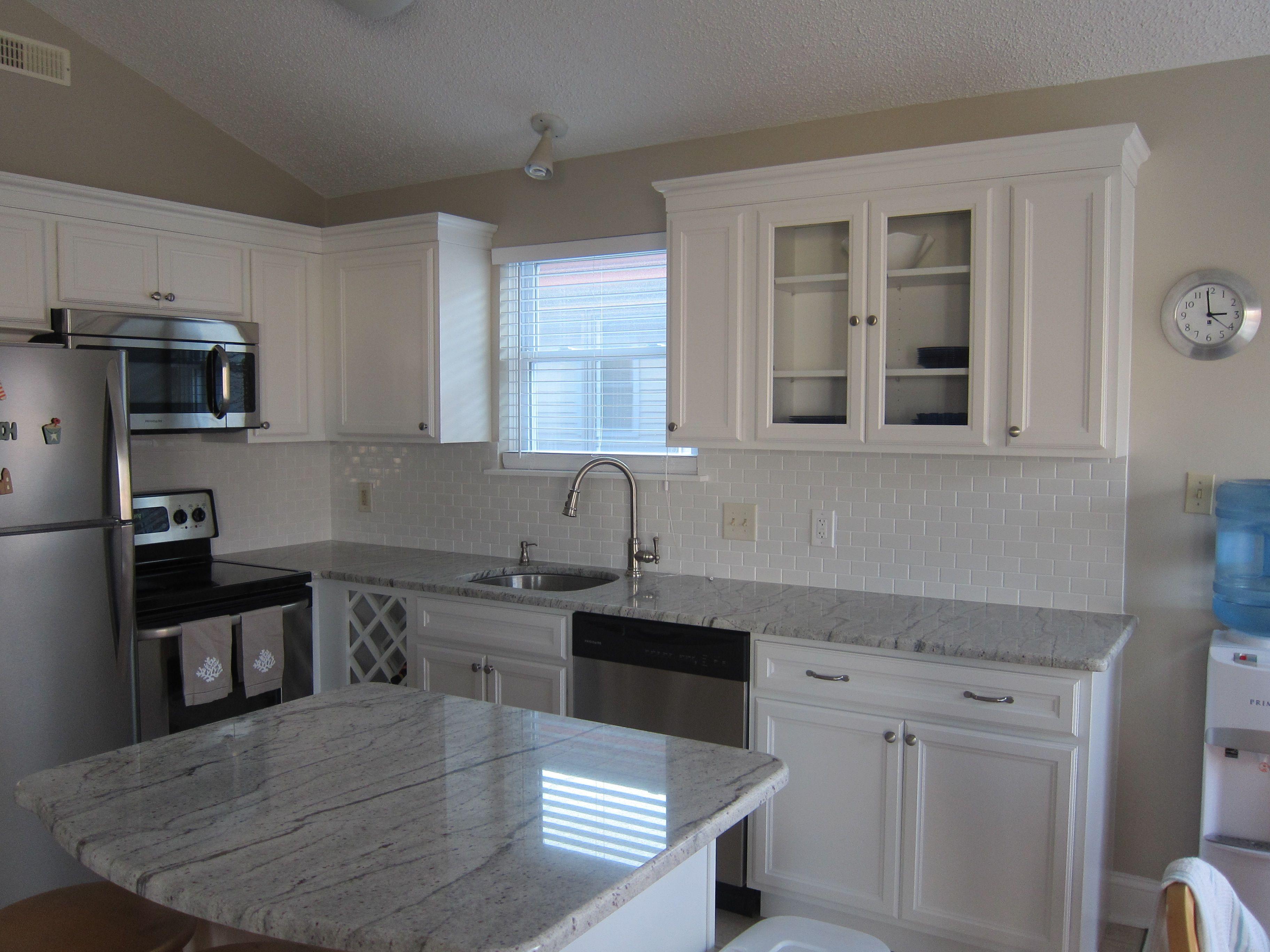 river white granite, shaker style cabinets, white subway tile back ...