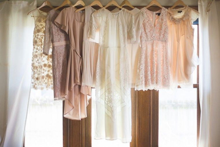 Vintage Wedding Gown Hung In Window With Bridesmaids