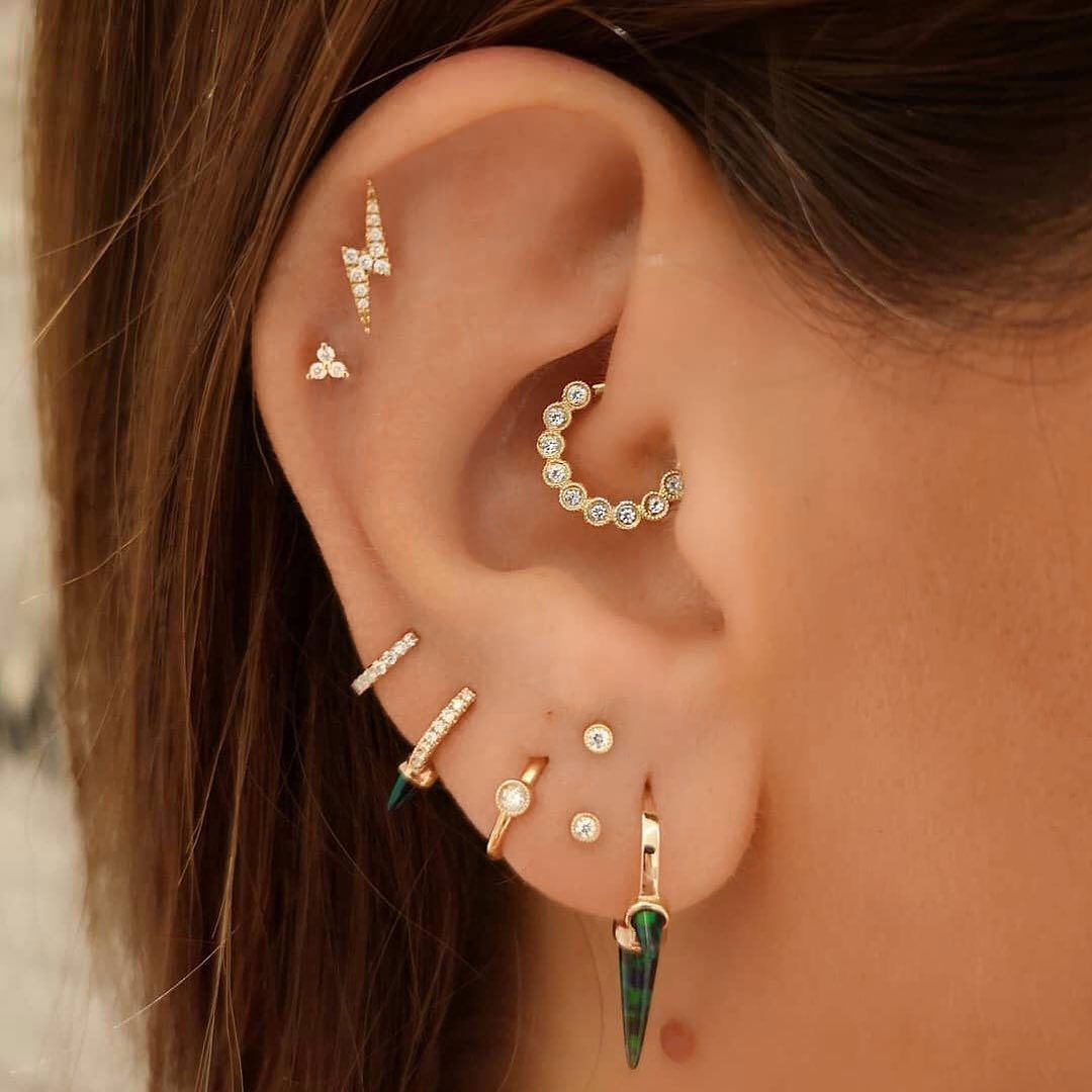 """Maria Tash on Instagram: """"This ear project was just finished, with the addition of a pair of scalloped set diamonds in new stacked lobe piercings. The client's other…"""""""