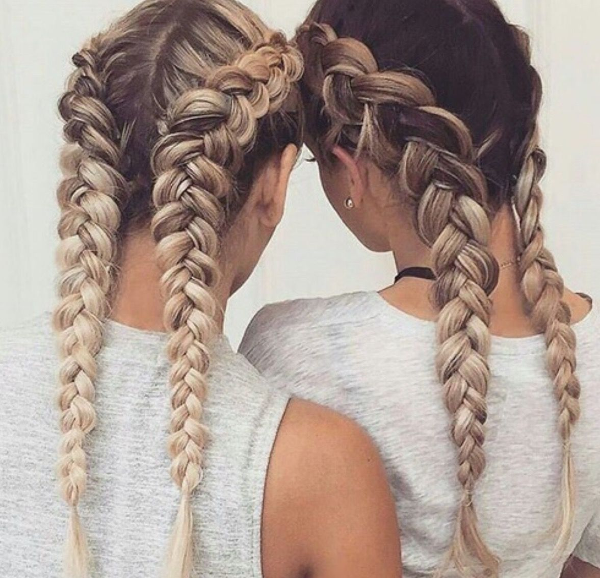 two loose boxer braids on long highlighted hair-- looks even