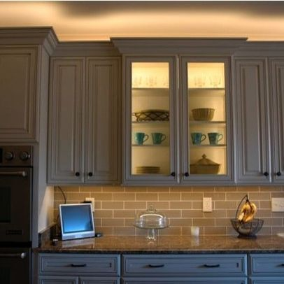 led lighting above cabinet and inside glass cabinet, undercabinet
