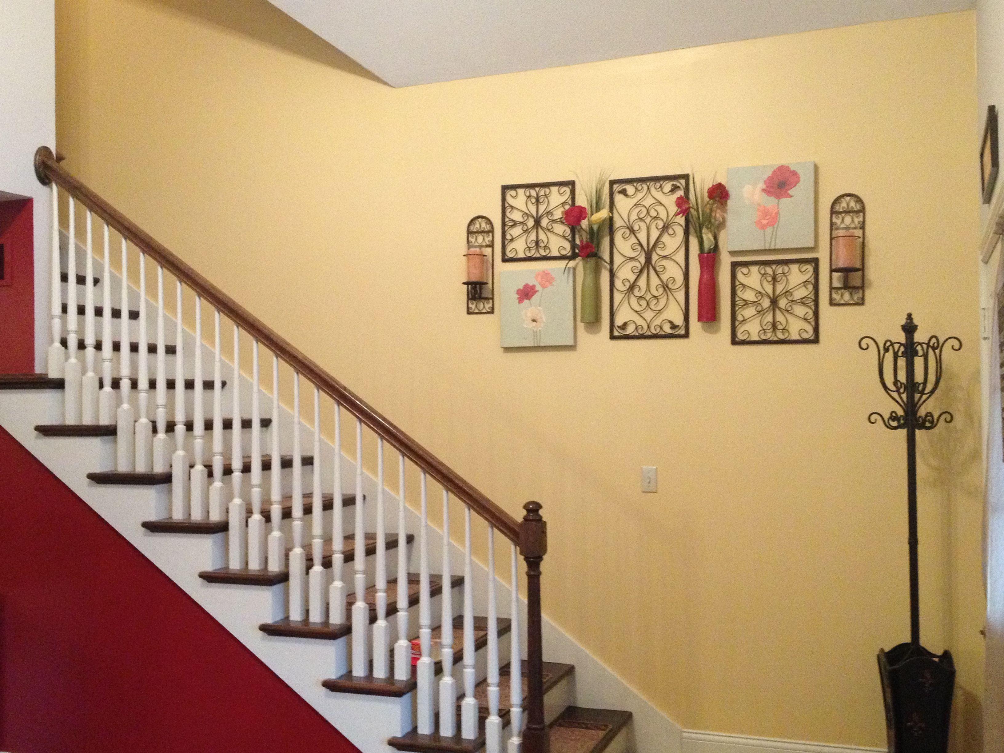 Yellow and red accented walls in living room and stair case. | Home ...