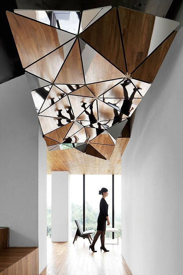 At Hotel Wind in Xiamen, China, rainwater descends from the roof through the guest levels to reach a pool in the lobby