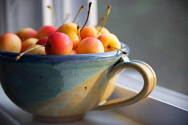 Rainier Cherry Salad--Serves 8.  2 lbs cherries, pitted and halved  4 oz. cream cheese  4 oz. sour cream  1/4 cup gran. sugar  1/2 tsp. vanilla    Mix ingredients thoroughly and then mix in cherries.  Then mix 1/2 c. brown sugar and 1/2 c. crushed pecans for a topping.  Voila!