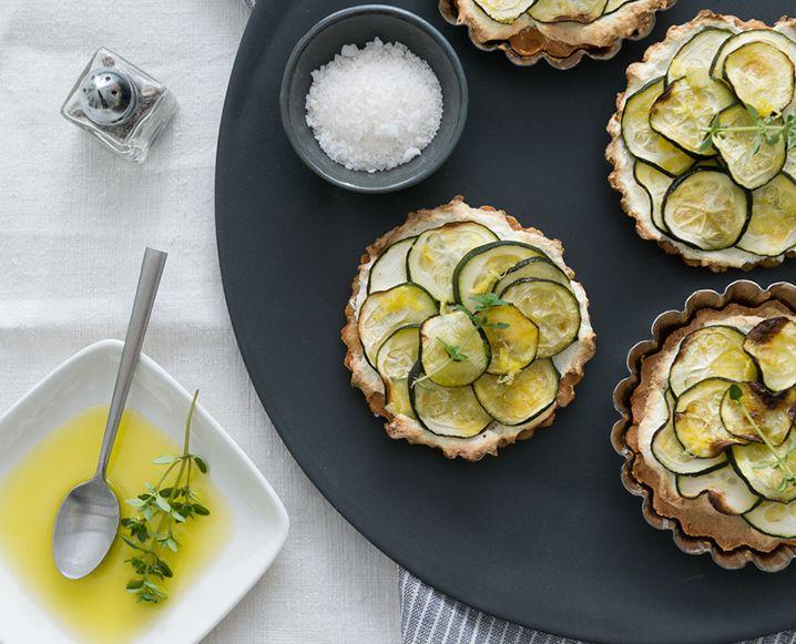 These vegetarian, gluten-free zucchini tarts put our favorite summer veggie in…