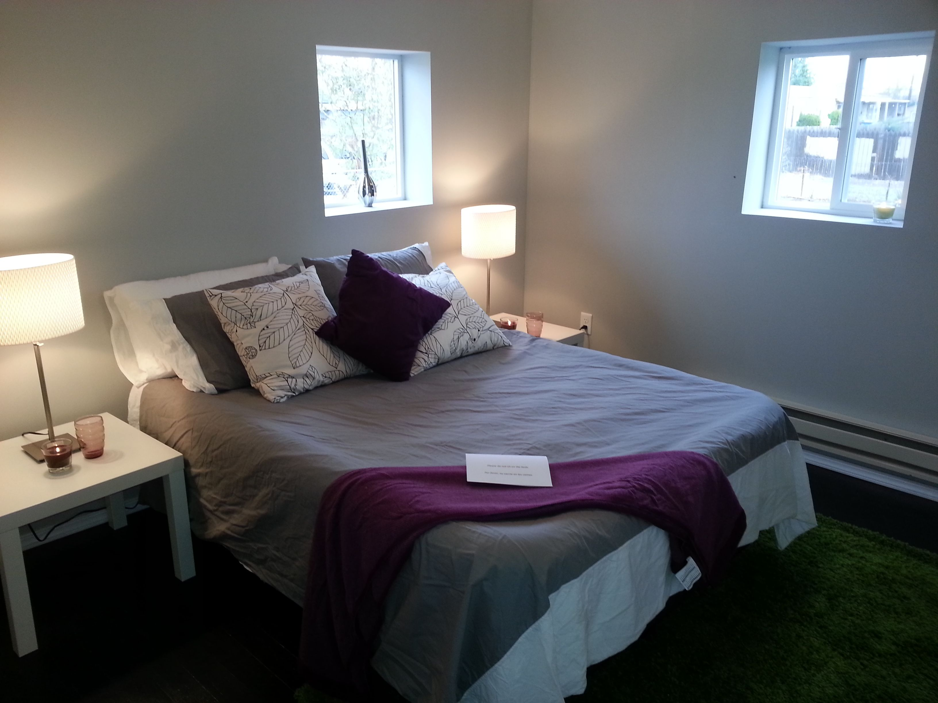 Chic master bedroom with gray and eggplant