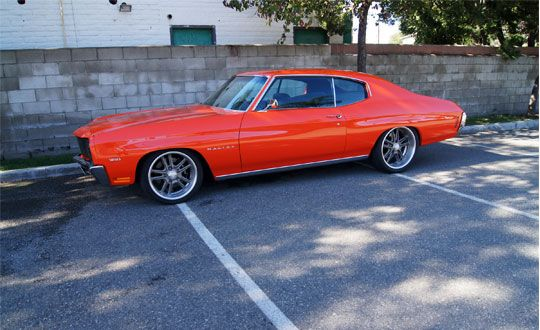 ProTouring '70 Malibu built by Brauns muscle car and hotrod restoration. brushed wheels. orange