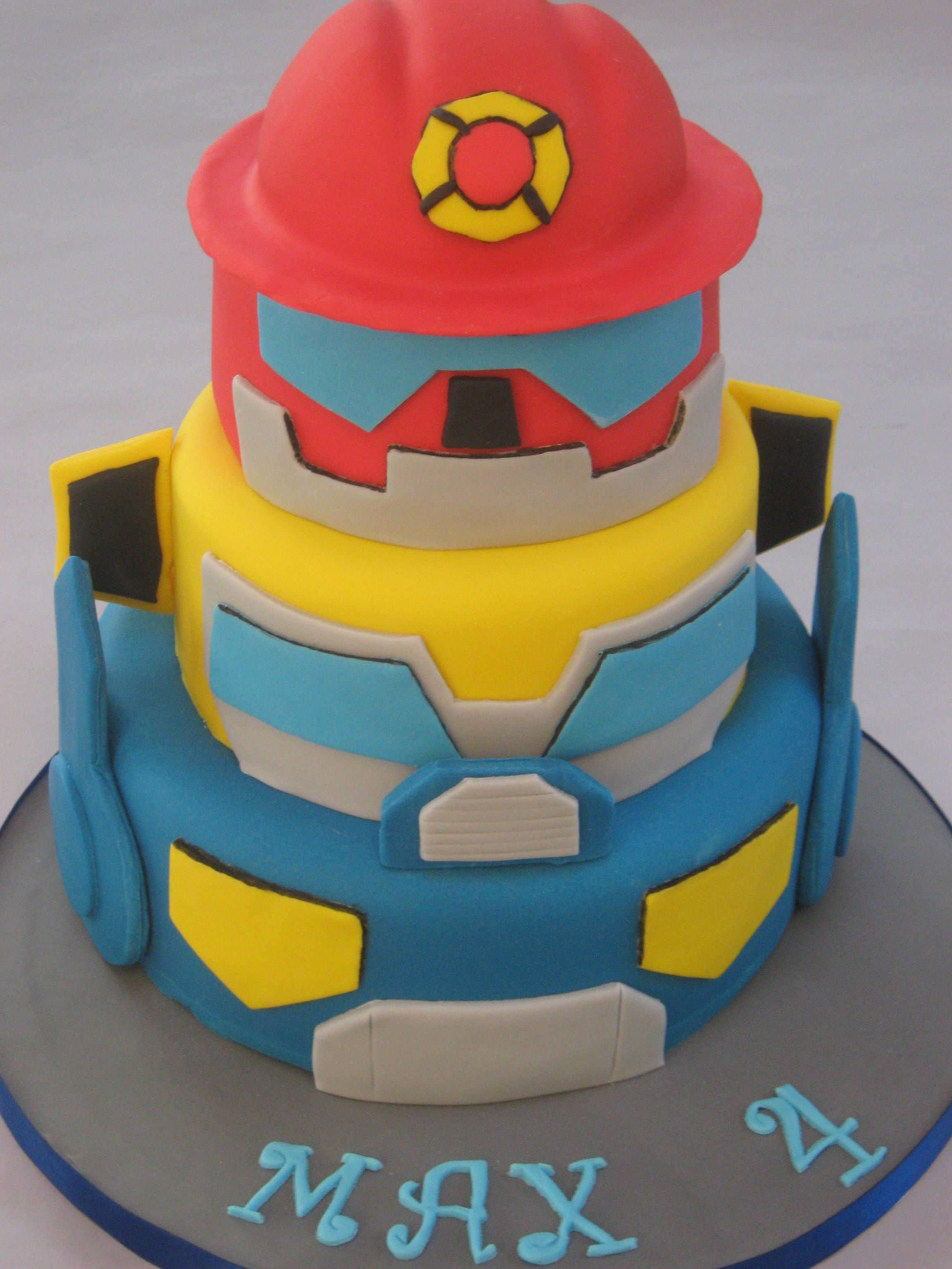 Pleasing Three Tiered Chocolate And Vanilla Sponge Rescue Bot Cake Funny Birthday Cards Online Alyptdamsfinfo
