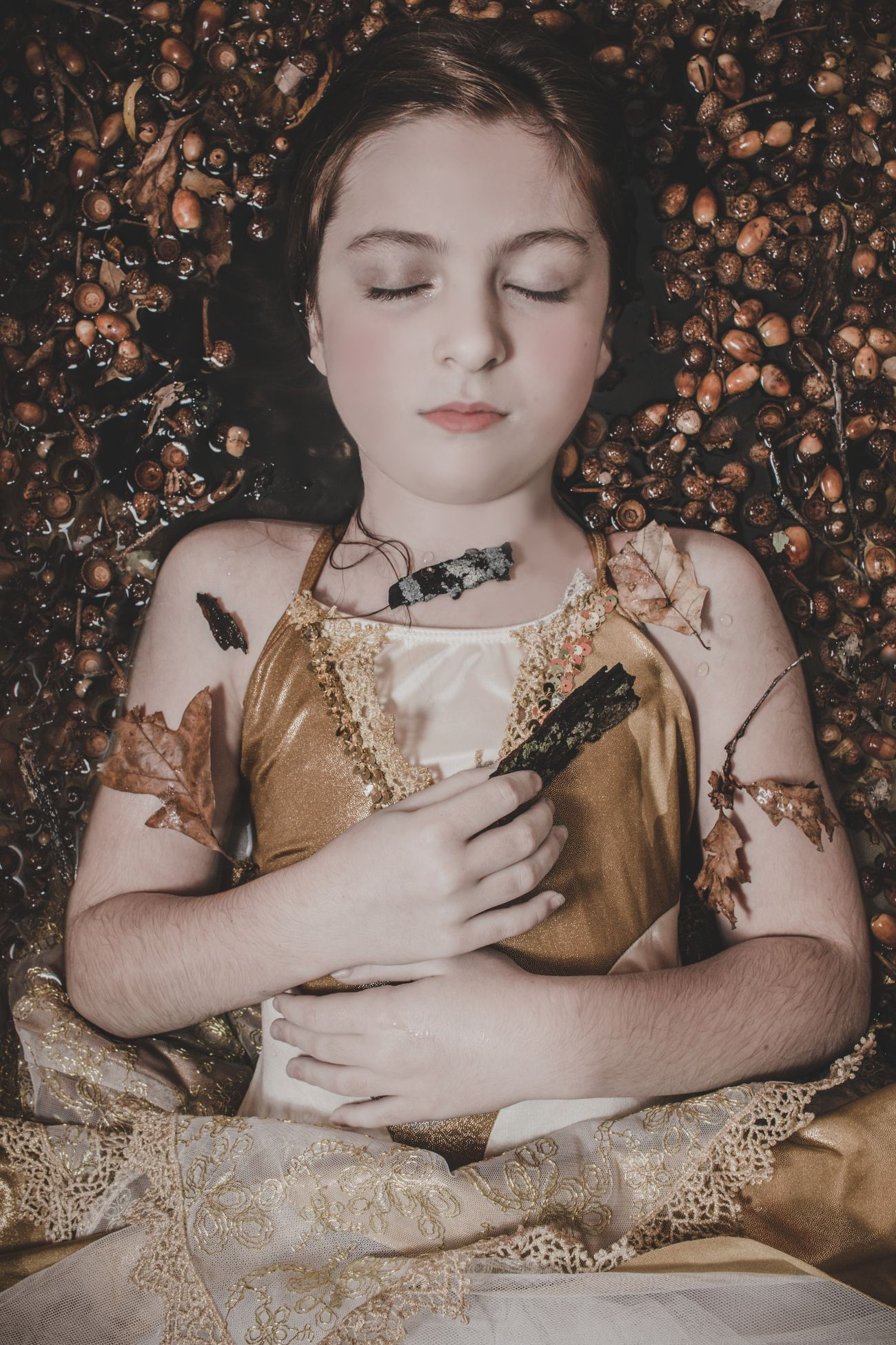 Girl in the Garden laying down in acorns