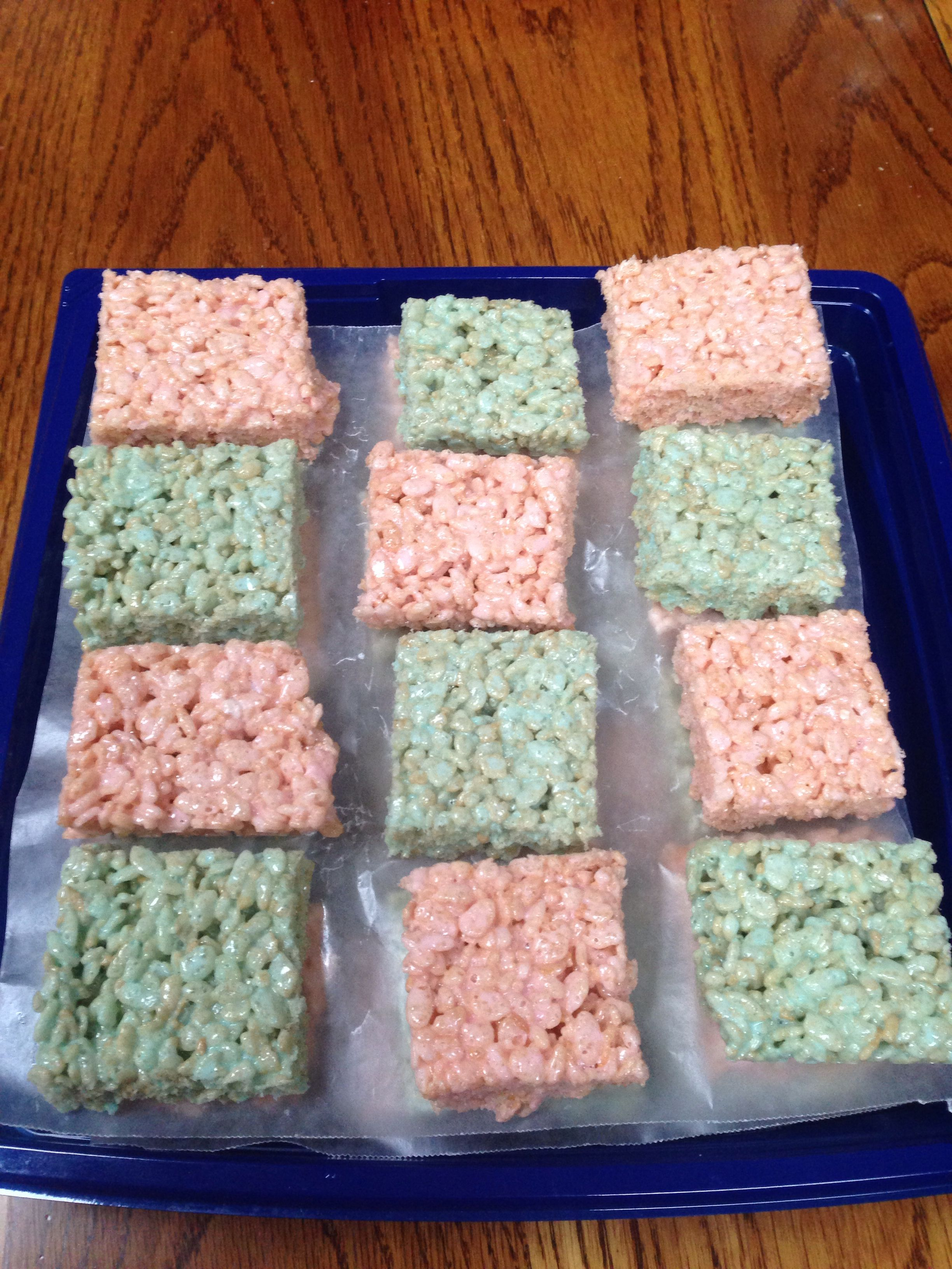 Pink and blue Rice Krispie treats as a dish for Baby Gender Reveal