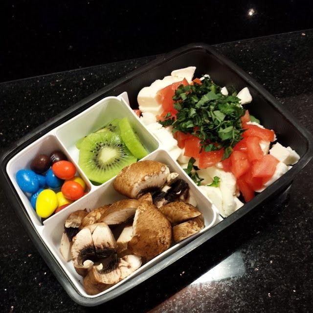 Caprese Salad (fresh mazzarella, tomatoes, basil, salt and pepper), kiwi slices, portebella mushroom chunks, peanut M&Ms