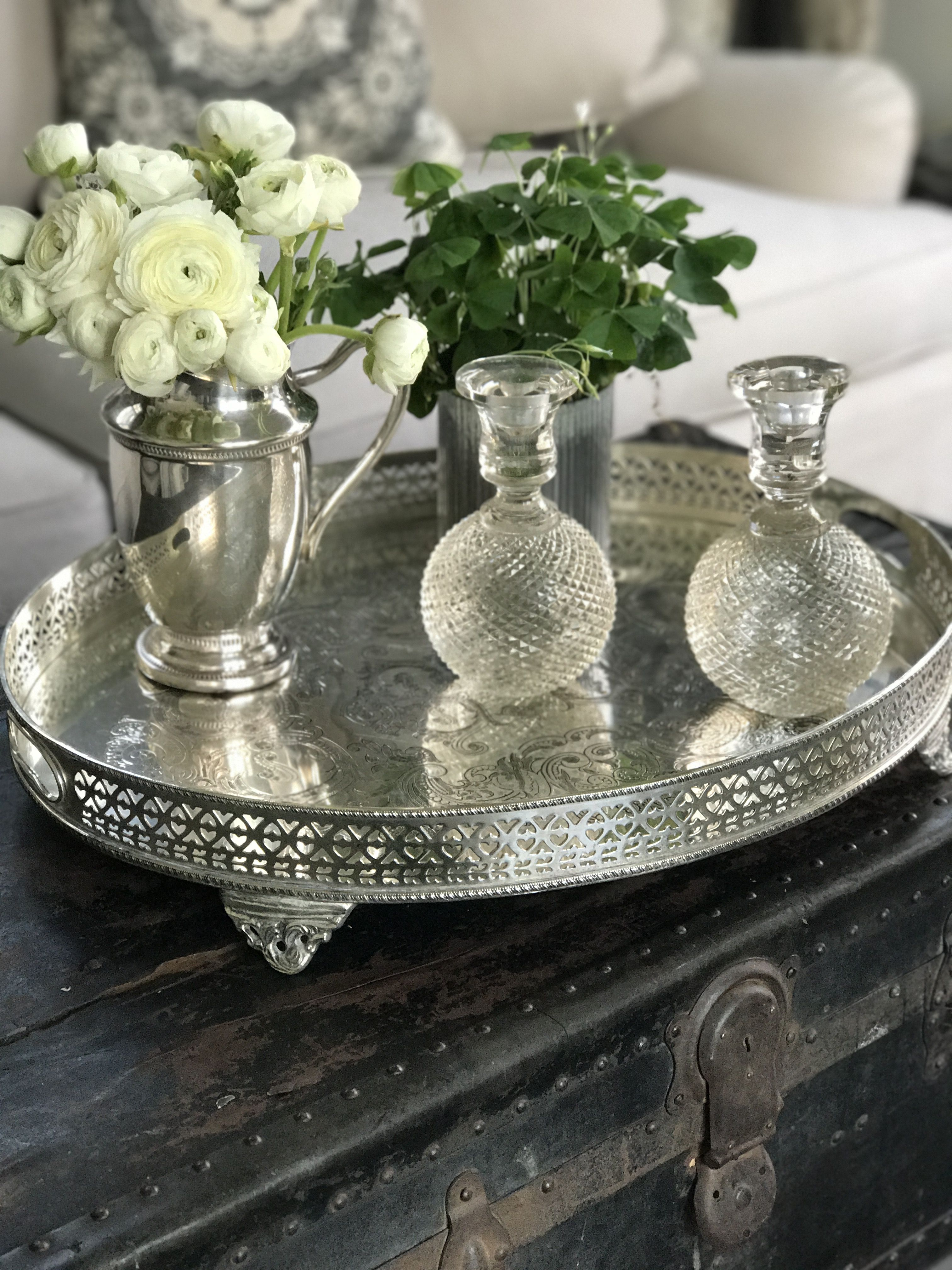vintage silver tray on vintage trunk