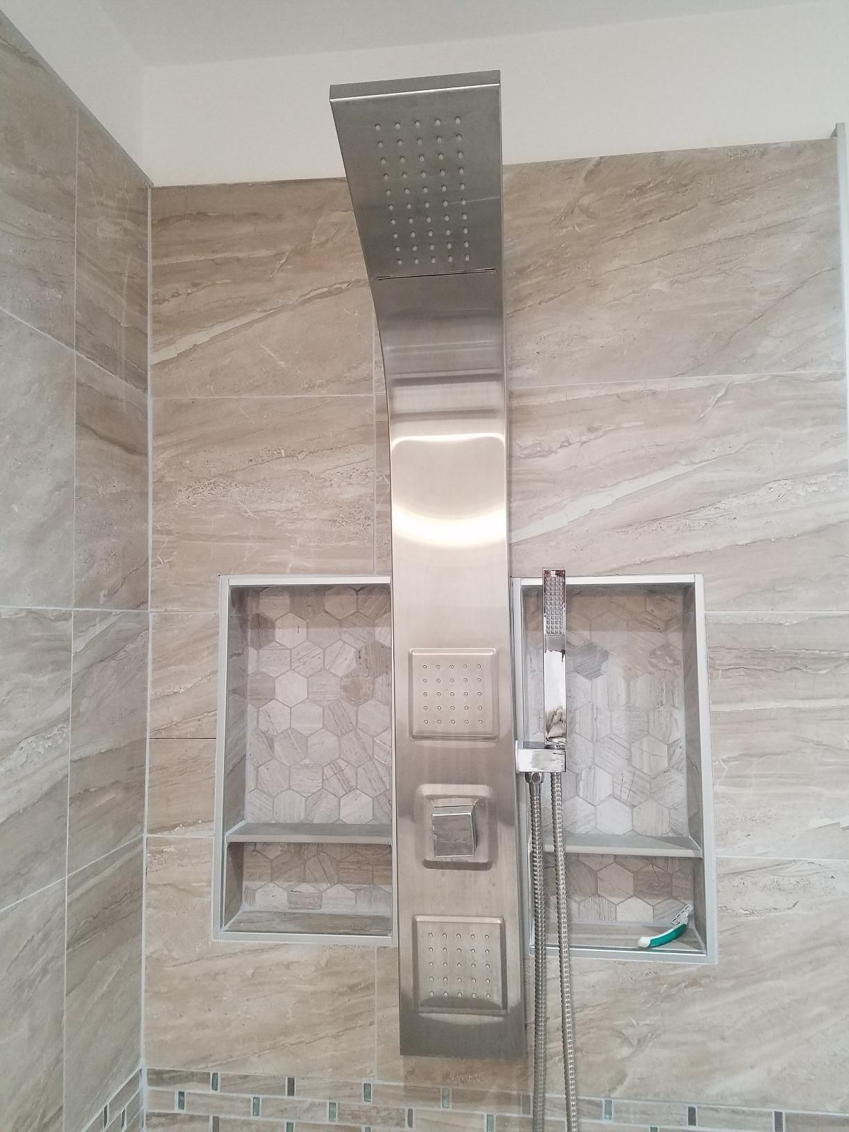 how to take a shower head off the wall