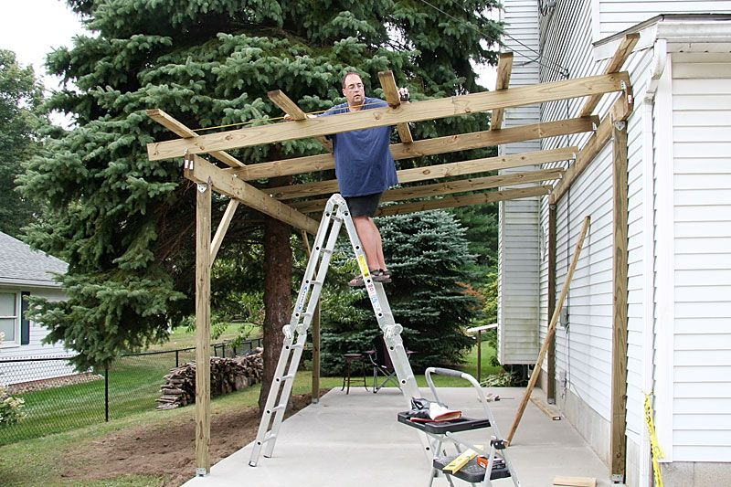 Done We Also Installed A Light With Motion Detector In The Carport Building A Carport Carport Designs Carport Plans