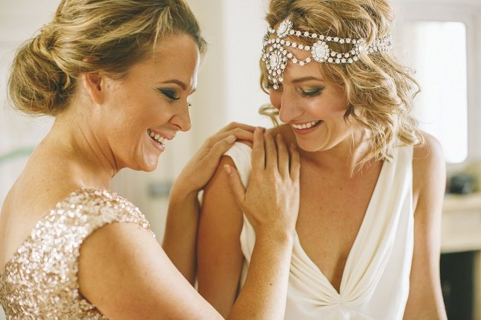 Love this moment of bride and maid | Bride wears Bo and Luca headpiece | I take you #headpieces #bridalheadpiece