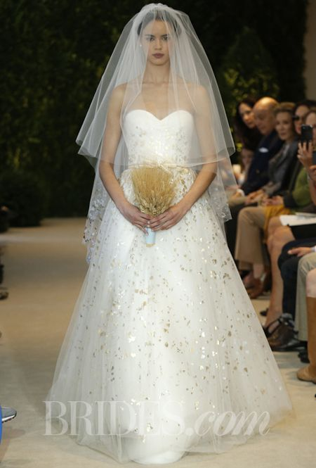 A tulle wedding dress with hand painted gold accents by carolina a tulle wedding dress with hand painted gold accents by carolina herrera junglespirit Choice Image