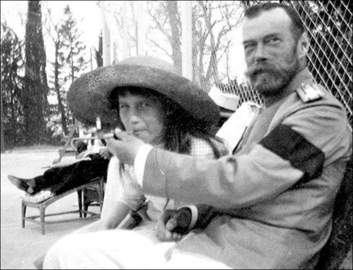 Tsar Nicholas II allows his daughter, the Grand Duchess Anastasia, to smoke.