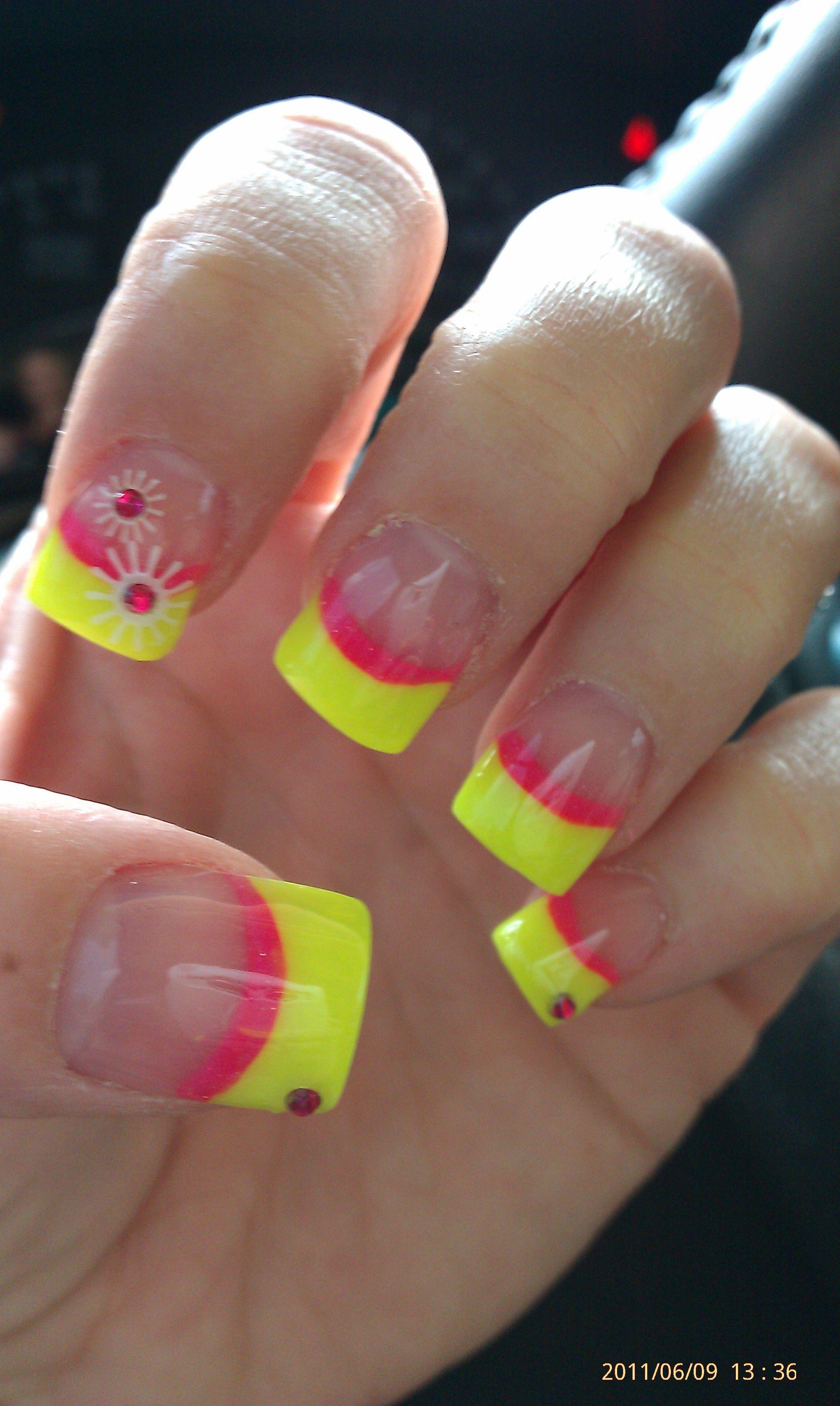 bright pink/yellow acrylic w/ white Konad nail art and pink jewels.