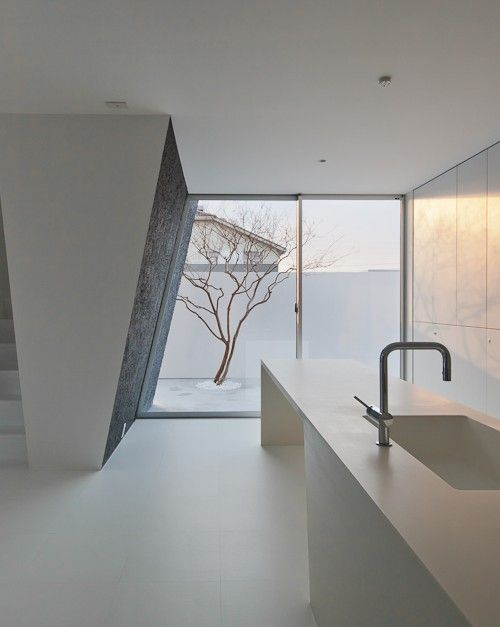 Minimal kitchen area, the Ginan House in Japan by Keitaro Muto Architects _