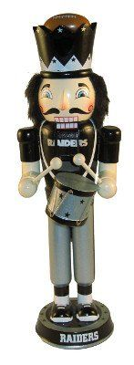 """Oakland Raiders 2012 14"""" Drummer Nutcracker by Forever Collectibles. $19.40. Lever opens and closes the jaw for classic appeal; Team logo and uniform add a fun touch to your Christmas decorations; Measures 14 inches. Put your team pride on display with this 14"""" Drummer Nutcracker from Forever Collectibles. Decked out in a team uniform and holding a drum, this nutcracker is gearing up for the holidays. Finish off your Christmas decor with this highly collectible nutcracker..."""