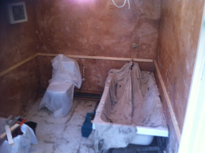 Plastering of the walls and allowing it to dry before adding the new tiles.